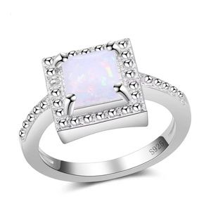 Jewelry - S925 sterling plated imitation white opal ring.